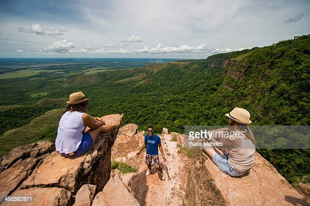 A group enjoy the view of the Chapada dos Guimaraes on November 17 2013 near Cuiaba Brazil The area is constituted as a national park and is located...
