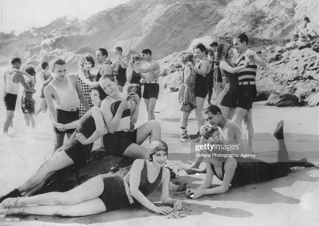 A group enjoying the sun at a beach party in California.