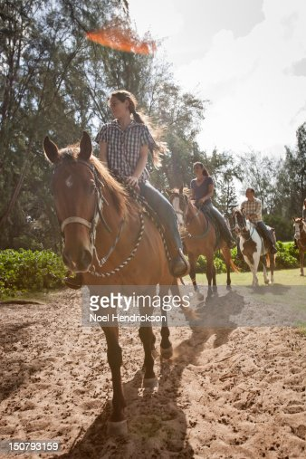A group explores a trail on horseback : Stock Photo