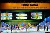 Group F containing ArgentinaBosniaHerzegovina Iran and Nigeria is displayed on the big screen on stage behind the draw assistants Fernanda Lima and...
