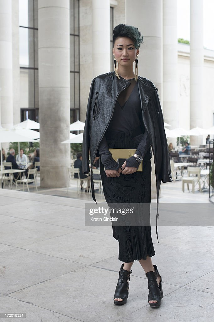 Group Fashion Director of The Rake Esther Quek wears Michael Kors shoes with a Harry Halim dress and jacket on day 3 of Paris Collections: Men on June 28, 2013 in Paris, France.