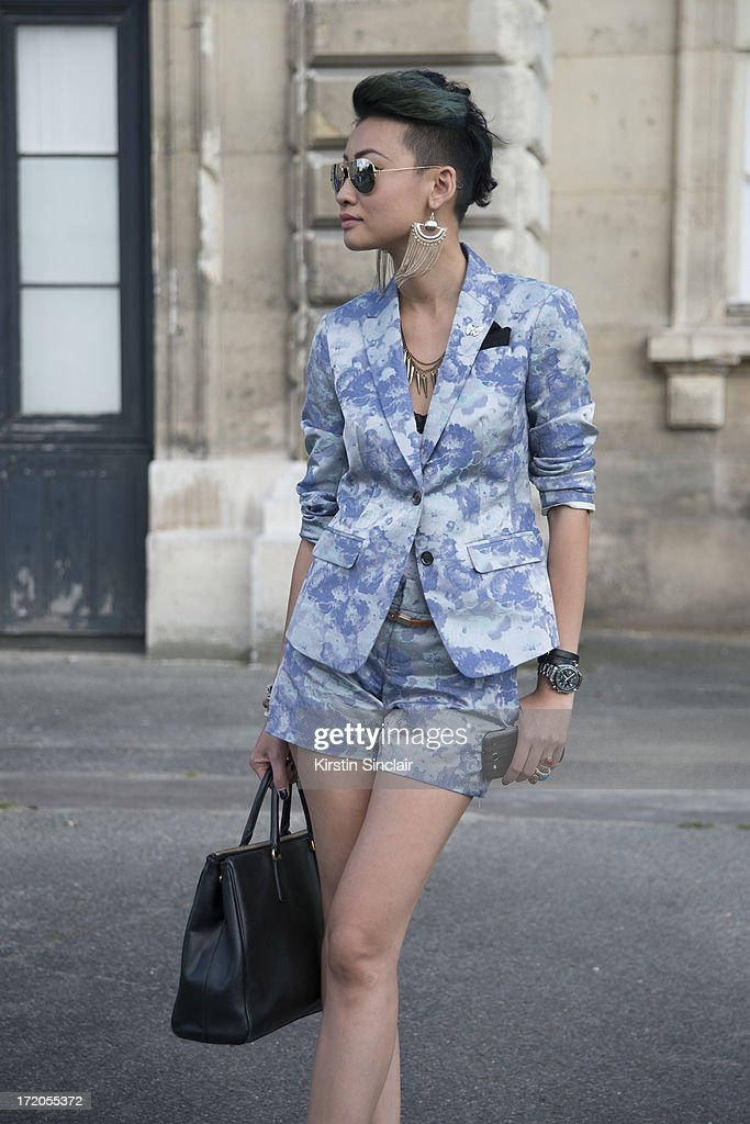 Group Fashion Director of The Rake Magazine Esther Quek wears a Banana Republic suit Ray Ban sunglasses on day 5 of Paris Collections: Men on June 30, 2013 in Paris, France.