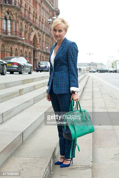 Group fashion editor for The Rake Magazine Sarah Ann Murray wears a bespoke suit Ralph Lauren bag and Nicholas Kirkwood shoes on day 2 of London...
