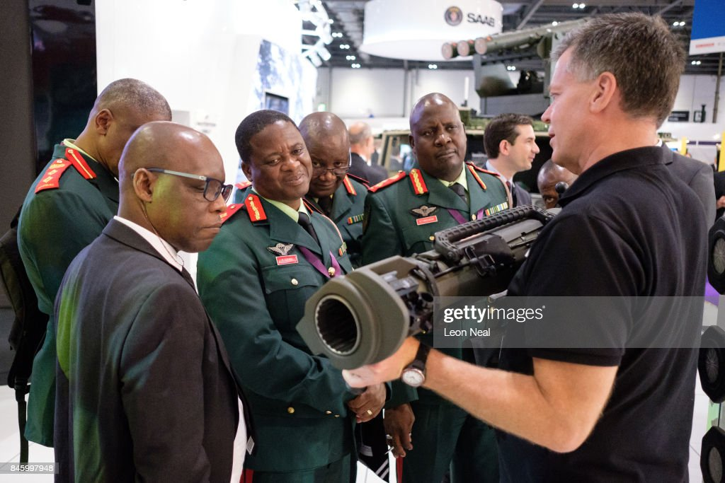 A group from the Botswana military look on as a member of the SAAB team explains their latest rocket-propelled weapons at the DSEI event at the ExCel centre on September 12, 2017 in London, England. The annual weapons and security trade fair sees manufacturers of all aspects of military, naval, airforce and security from all over the world display their latest designs to delegates.