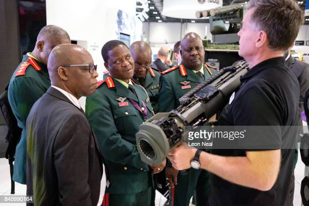 A group from the Botswana military watch as a member of the SAAB team explains their latest rocketpropelled weapons at the DSEI event at the ExCel...