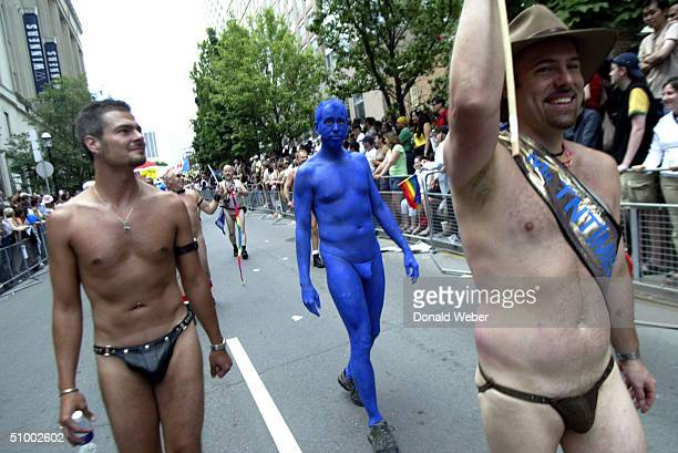 A group from the gay nudist organization Totally Naked Toronto marches past spectators during the Pride Parade in support of gay lesbian bisexual...