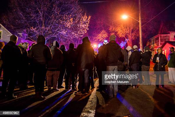 A group gathers in front of a police line after 5 people were shot at a Black Lives Matters protest November 24 2015 in Minneapolis Minnesota...