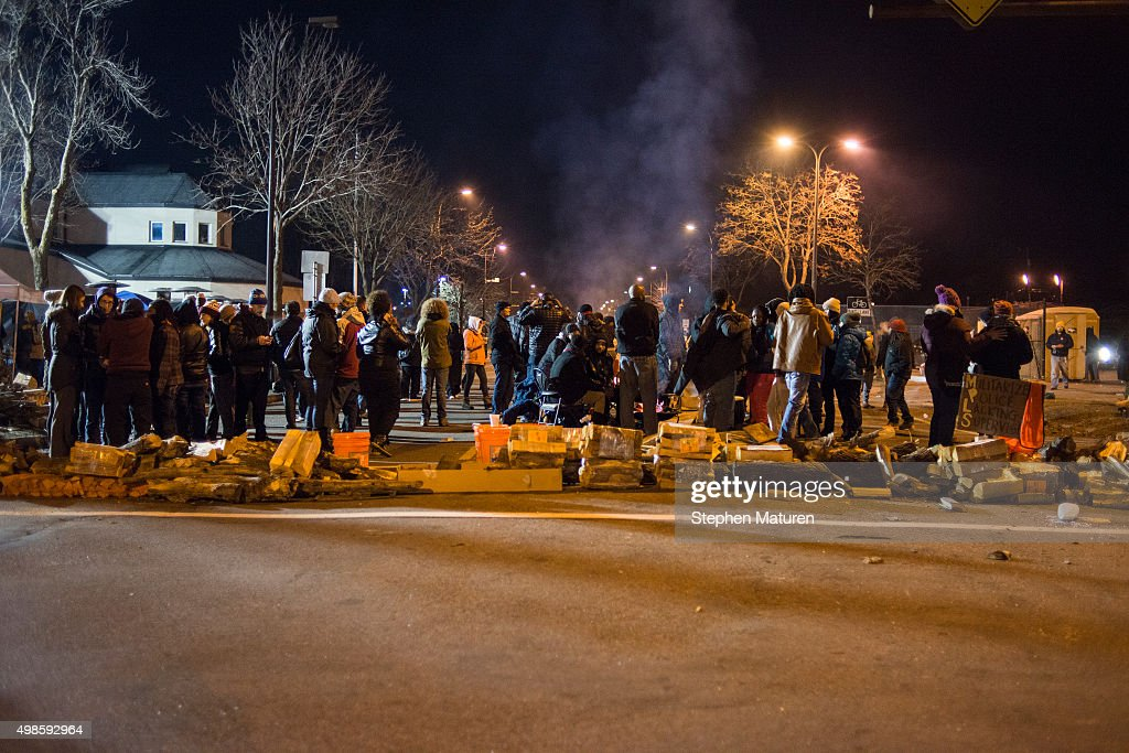 A group gathers outside of the 4th Precinct Police Station after 5 people were shot at a Black Lives Matters protest November 24 2015 in Minneapolis...