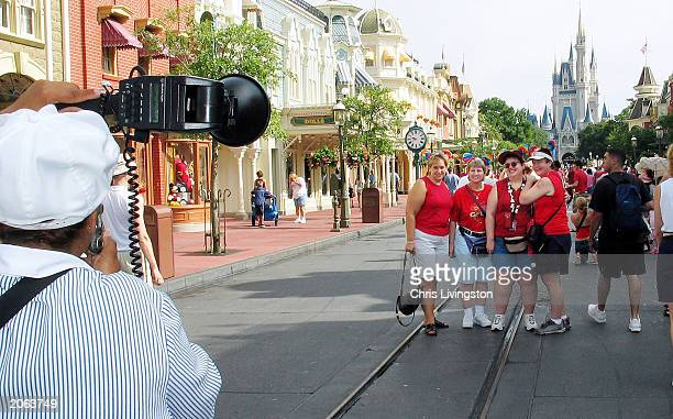A group gets a souvenir picture taken in front of Cinderella's Castle at Disney World's Magic Kingdom during 'Gay Days' weekend organized by Gay Days...
