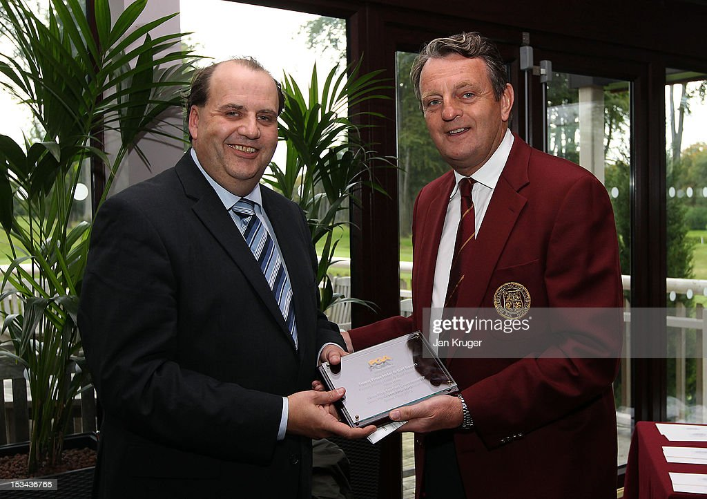 Group Golf Manager Andrew Cook(L) receives a plaque from PGA Captain Eddie Bullock during the final round of the Skins PGA Fourball Championship at Forest Pines Hotel & Golf Club on October 5, 2012 in Broughton, England.