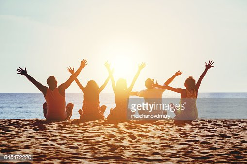 Group happy people beach sea sunset concept : Stock Photo