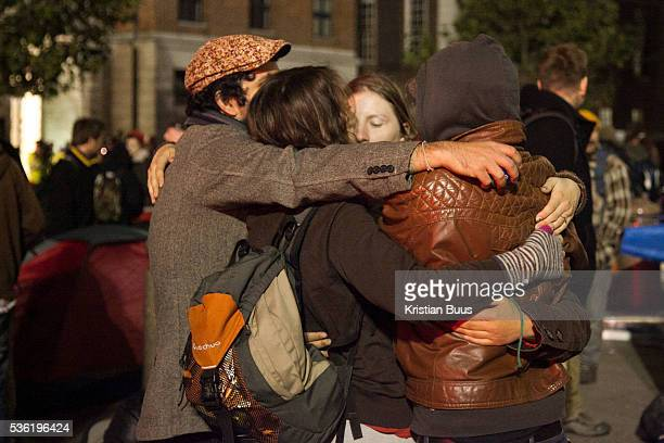 A group hug to keep warm and to keep up the spirit The London Stock Exchange was attempted occypied in solidarity with Occupy Wall in Street in New...