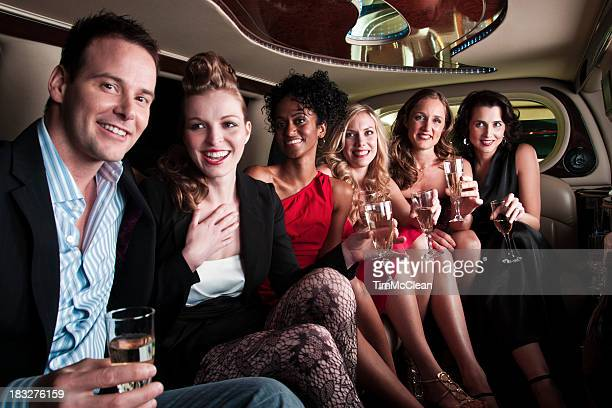 Group  in  a limousine  having drinks on  way   to party