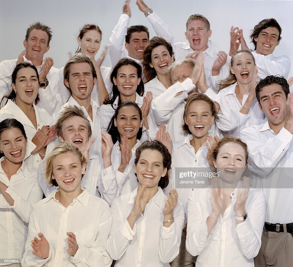 Group in white shirts clapping, high section, portrait : Stock Photo