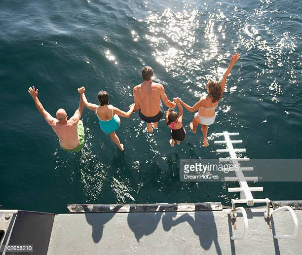 Group jumping into water