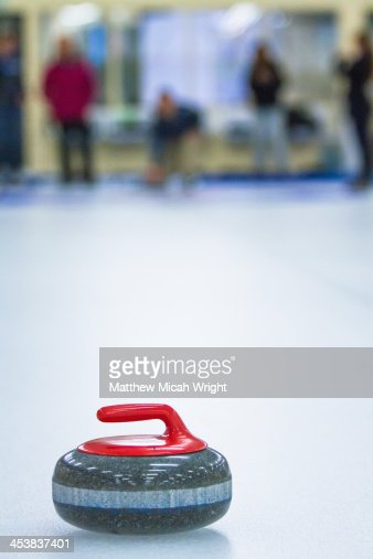 A group learns the sport of curling.