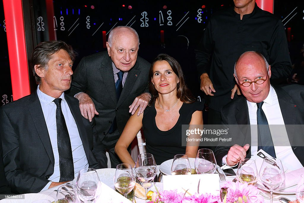 CEO group M6 Nicolas de Tavernost, Pierre Berge, Minister of Culture and Communication Aurelie Filippetti and CEO of Quai Branly Museum Stephane Martin attend 'Friends of Quai Branly Museum Society' dinner party at Musee du Quai Branly on September 9, 2013 in Paris, France.