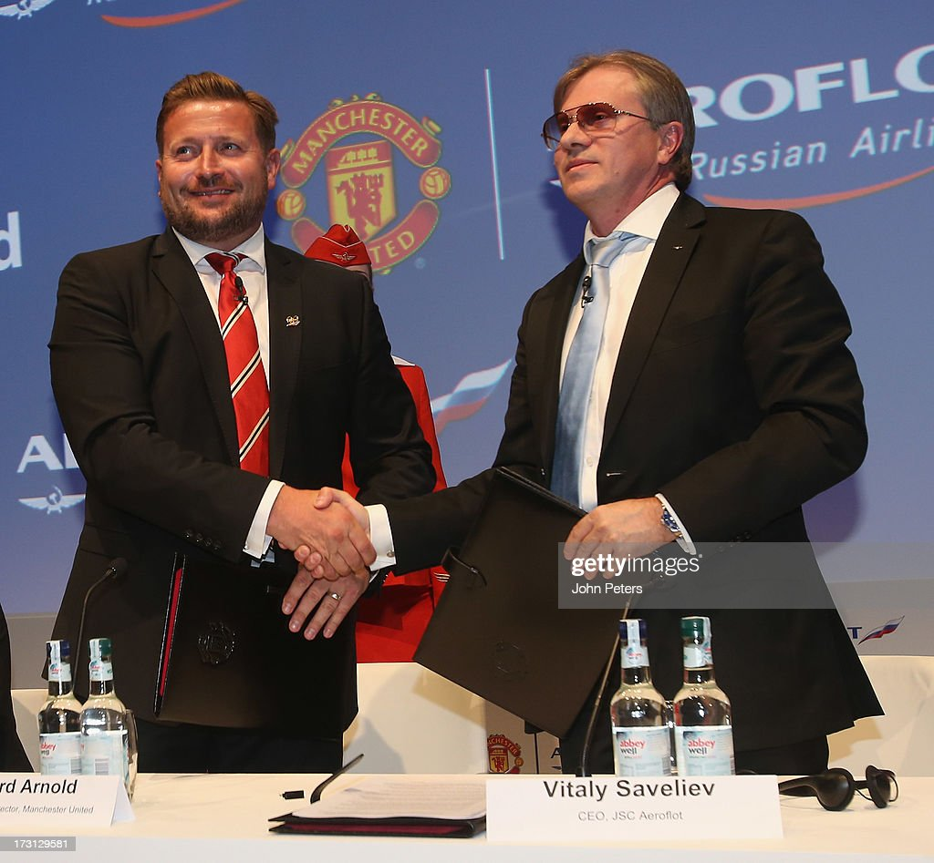 Group Managing Director Richard Arnold of Manchester United poses with CEO of Aeroflot Vitaly Saveliev after the press conference to announce...