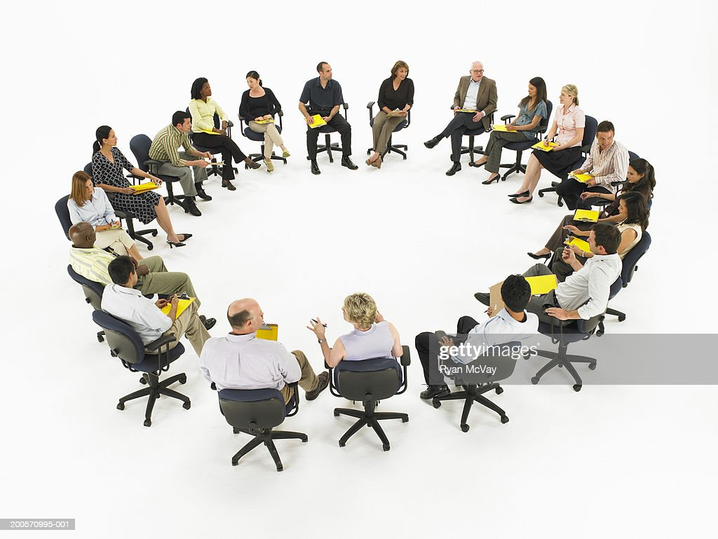 Group meeting forming circle, elevated view : Stock Photo