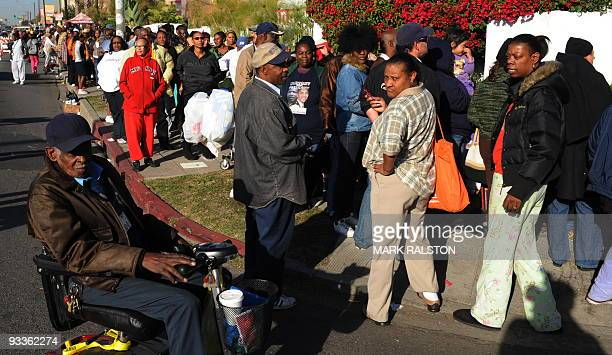 A group of 10000 lowincome and needy people who lined up to receive free Thanksgiving turkeys and fixings distributed by the Jackson Limousine...