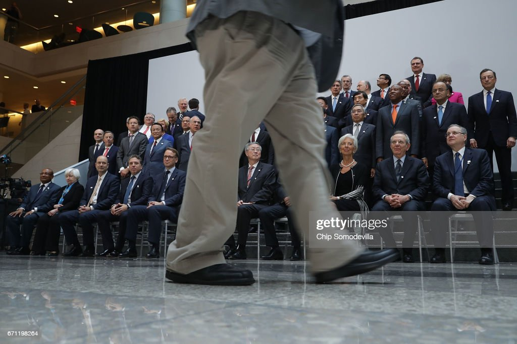 Group of 20 Finance Ministers and central bank governors pose for a photograph in the lobby of the International Monetary Fund headquarters during the World Bank Group and IMF Spring Meetings April 21, 2017 in Washington, DC.