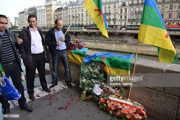 A group of 200 demonstrators lays wreath on the SaintMichel Bridge during a rally to mark the 52th anniversary of a police crackdown on Algerian...