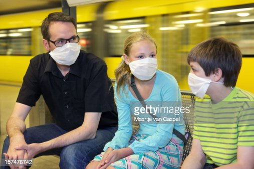 Group of 3 with masks on because of swine flu panic