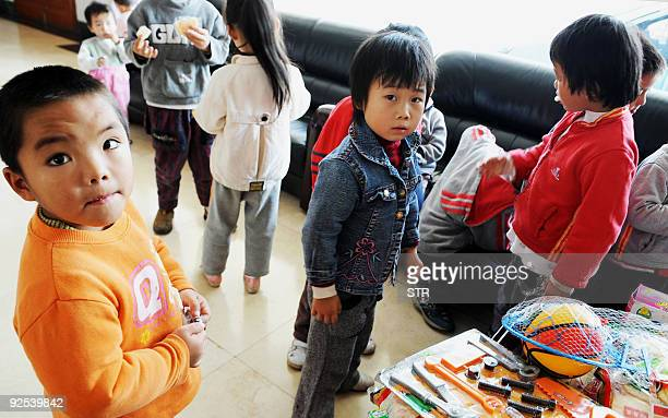 A group of 60 children are waiting to reunite with their parents after police rescued them from human traffickers at Guiyang Welfare Center for...