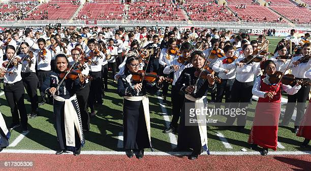 A group of 731 Clark County School District students perform on the field as they attempt to break the Guinness World Records title for biggest...