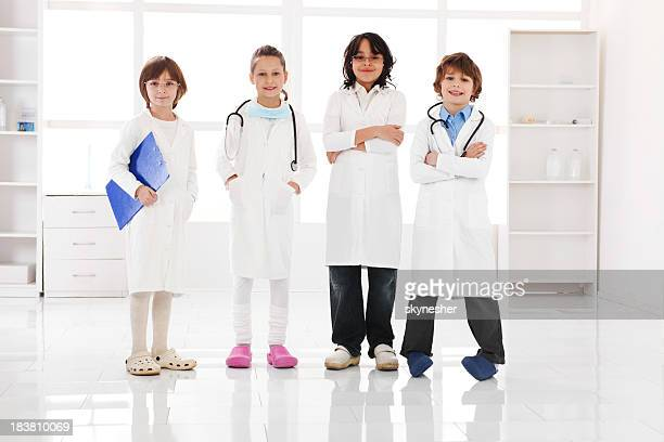 Group of a little children doctors standing in the office.
