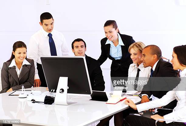 Group of a many business people sitting in the office.