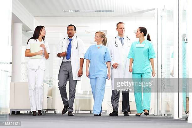 Group of a medical people walking.