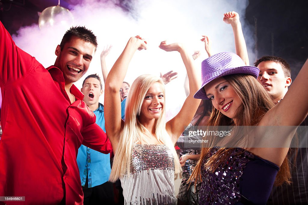 Group of a young people dancing at disco. : Stock Photo