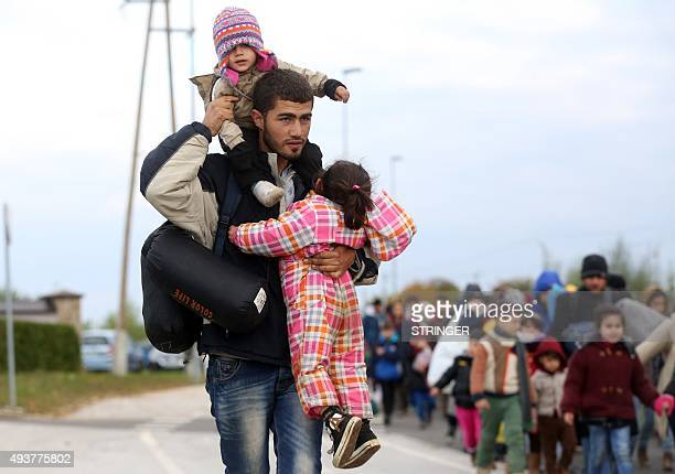 A group of about 1000 migrants walks from the border crossing with Croatia on October 22 near the village Rigonce to Dobova in Slovenia More than...