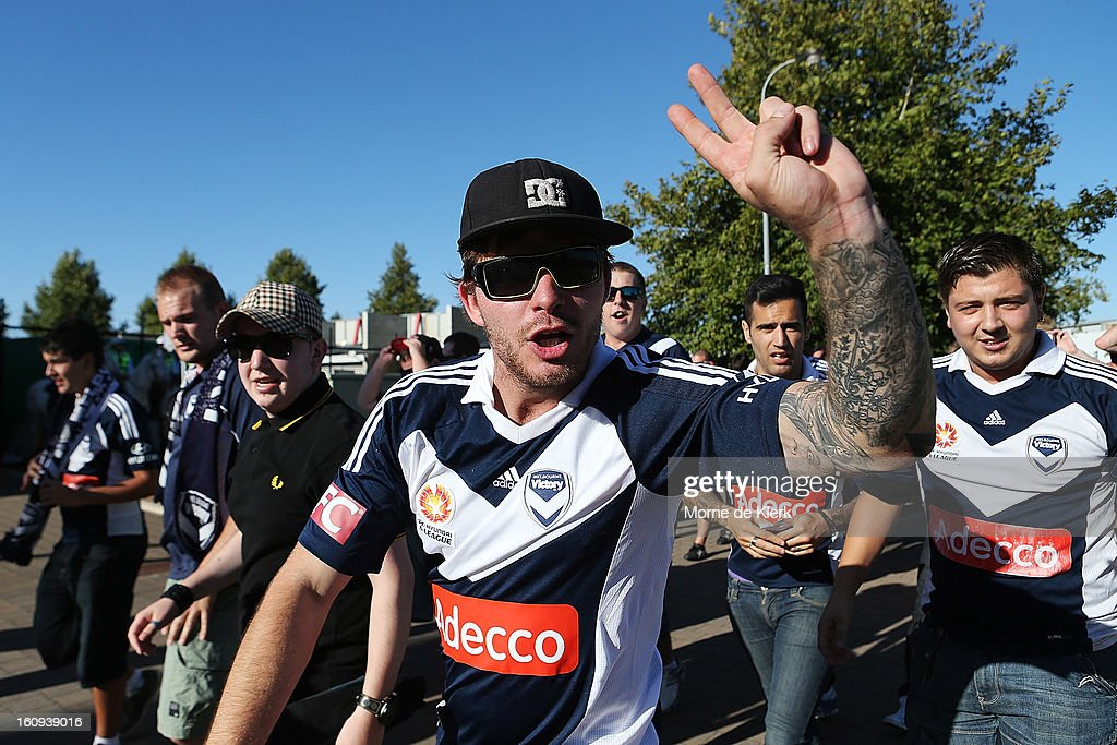 A group of active away Melbourne supporters arrive at Hindmarsh Stadium before the round 20 A-League match between Adelaide United and the Melbourne Victory at Hindmarsh Stadium on February 8, 2013 in Adelaide, Australia.