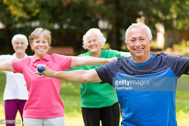 Group of active senior adults doing sport outdoors