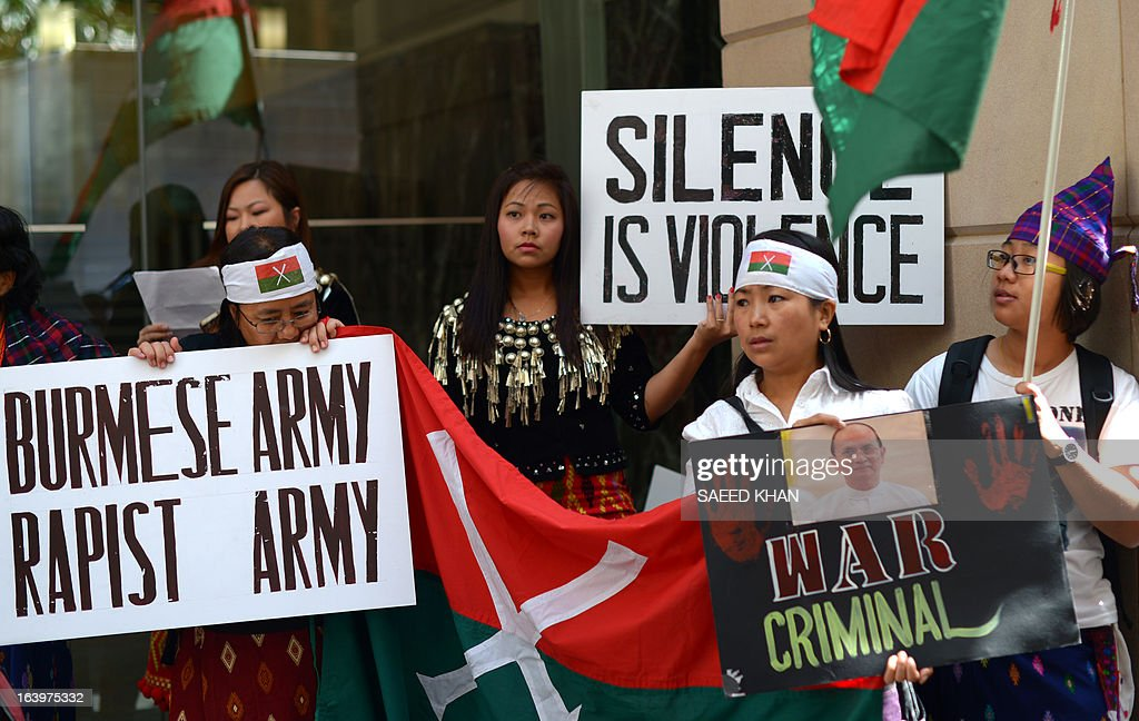 A group of activists from Myanmar protest against the Myanmar army in front of the Australia Department of Foreign Affairs and Trade (DFAT) in Sydney on March 19, 2013. Scores of Myanmar activists gathered in front of the DFAT and demanded Australian government to take a strong stance against ongoing human rights abuses in Myanmar and to condemn military attacks in Kachin state in northern Myanmar and ethnic violence against ethnic Rohingya Muslims. President Thein Sein is visiting Australia from 17 to 20 March and is the first by a head of state of Myanmar since 1974. AFP PHOTO / Saeed Khan