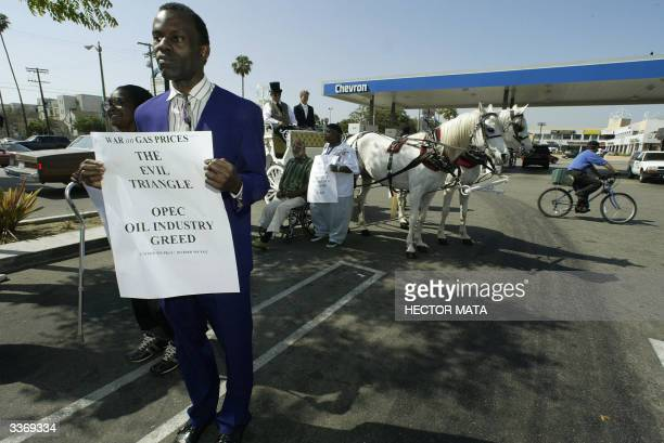 A group of activists protest the high gasoline prices in a Chevron gas station in Los Angeles 14 April 2004 The group called 'Citizens Against High...