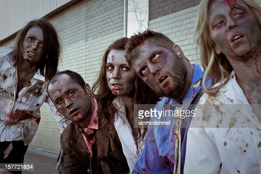 A group of adult zombies at a bus stop