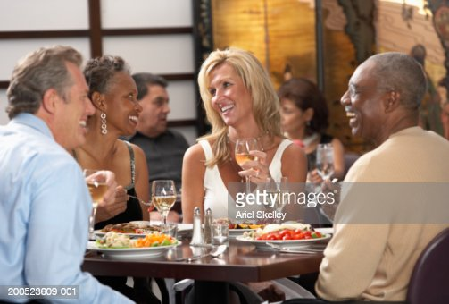 Group of adults eating in restaurant : Bildbanksbilder