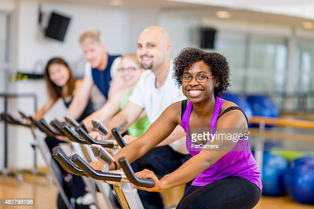 Group of Adults on Exercise Bikes in Fitness Class