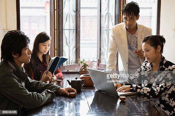 Group of adults with laptop computer