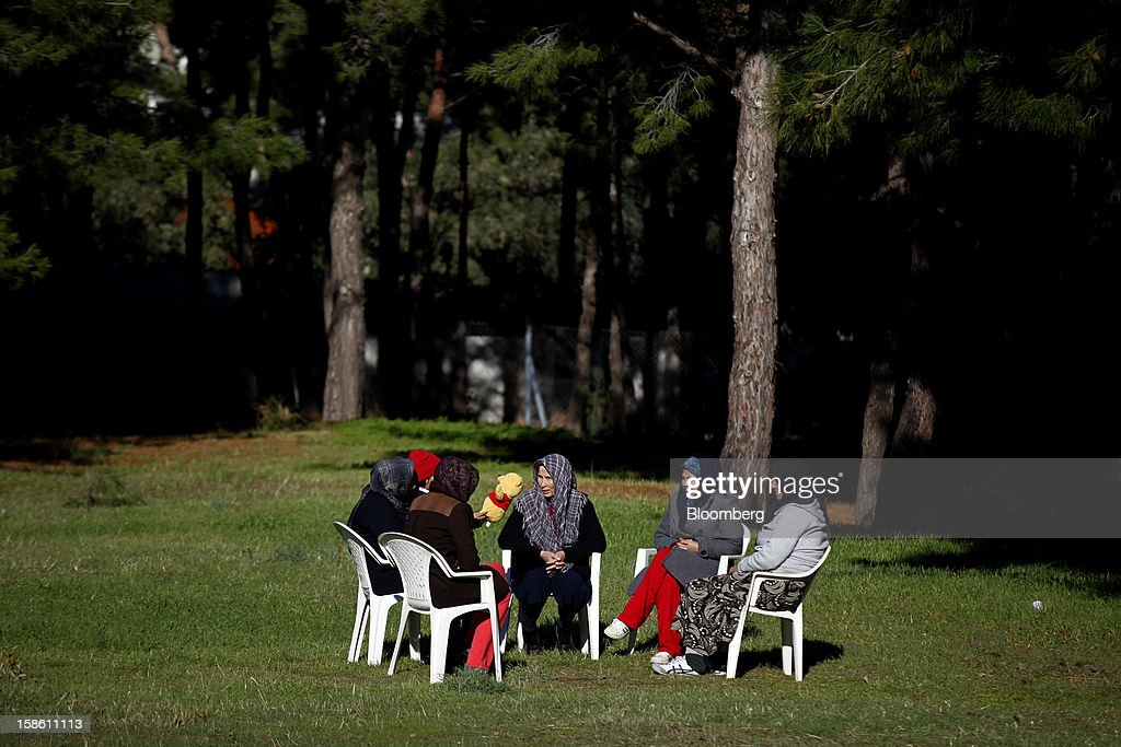 A group of Afghan migrant women talk in the grounds of the Pikpa summer camp, operated by Medecin Sans Frontiers (MSF) as a temporary shelter for refugees, near Mytilene, on the island of Lesbos, Greece, on Saturday, Dec. 8. 2012. In recent months, Lesbos has become a hot spot for migrants as Greece struggles to cope with waves of refugees from Middle Eastern conflict even as it reels from economic crisis at home. Photographer: Kostas Tsironis/Bloomberg via Getty Images