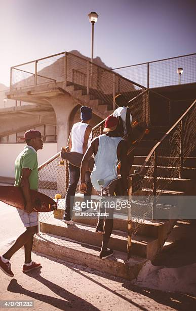 Group of African American teen skater friends in urban setting