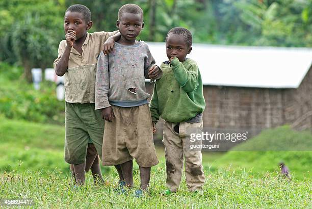 Group of african boys standing beside the road, North-Kivu, Congo