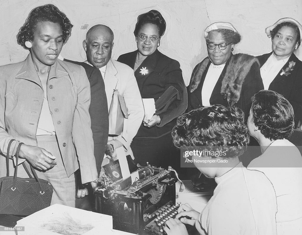 A group of AfricanAmerican people men and women in a line registering to vote before the deadline in the presidential and congressional elections...