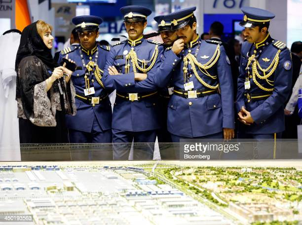 A group of air force officers are shown a map of Dubai as the tour the exhibition hall during the 13th Dubai Airshow at Dubai World Central in Dubai...