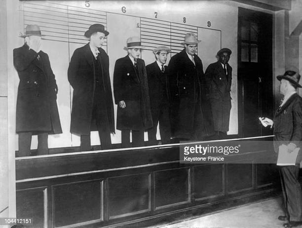 Group of alcohol traffickers at a Chicago police station on February 24 1930 During that time the police had completed a series of arrests hitting at...