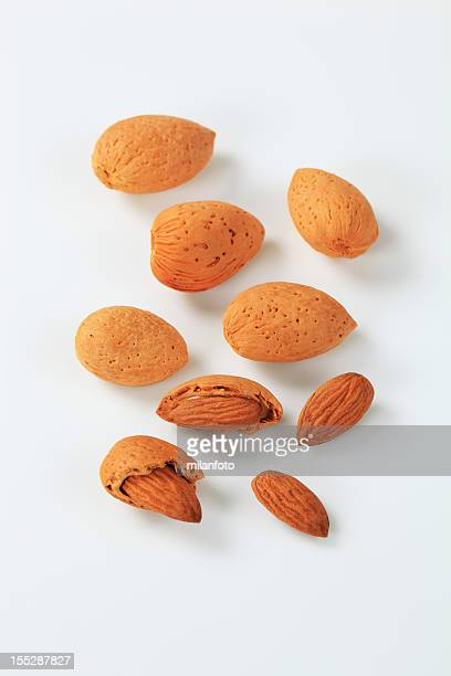 Group of almonds in a shell and without it