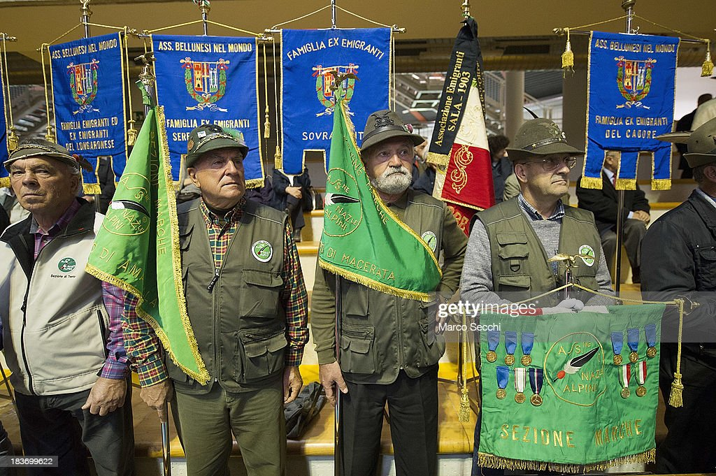 A group of Alpini stand during the memorial for the Vajont victims on the 50th anniversary on October 9, 2013 in Longarone, Italy. The Vajont disaster occurred on October 9, 1963 and claimed 2000 lives, making it the worst landslide in European history.